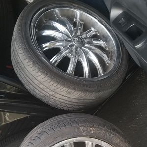 4 like new Tires with rims 17s